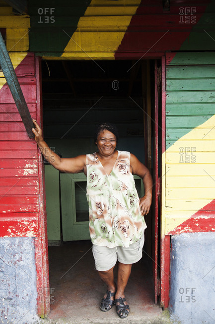 January 31, 2012: JAMAICA, Port Antonio. The owner of the Willow Wind Bar standing in the doorway.