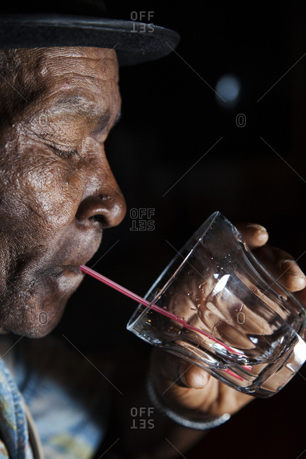 "January 31, 2012: JAMAICA, Port Antonio. Joseph ""Powder"" Bennett having a drink at the Bush Bar, Geejam Hotel."