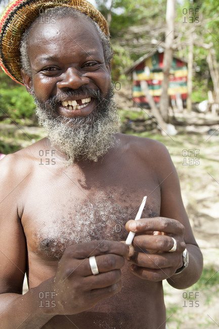 February 1, 2012: JAMAICA, Port Antonio. A rastafari at Winnifred Beach.