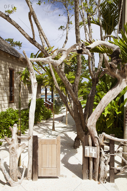 February 2, 2012: JAMAICA, Oracabessa. A path to the beach at the Goldeneye Hotel and Resort.