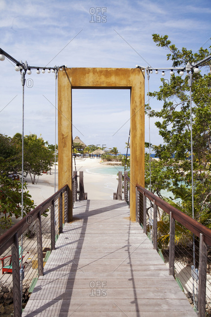 February 2, 2012: JAMAICA, Oracabessa. A view of the bridge and beach at the Goldeneye Hotel and Resort.
