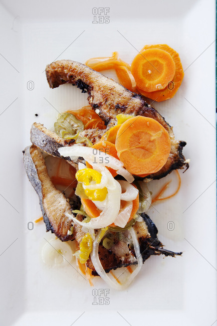 February 3, 2012: JAMAICA, Oracabessa. Goldeneye Hotel and Resort. Fried fish with pickled vegetables at the restaurant and bar during lunch.