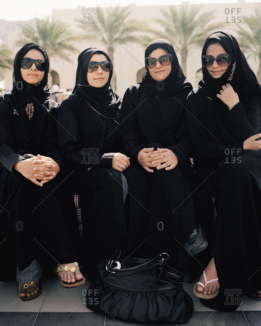 January 14, 2010: OMAN, Barr Al Jissa Resort and Spa, Muslim women sitting side by side in traditional clothing.
