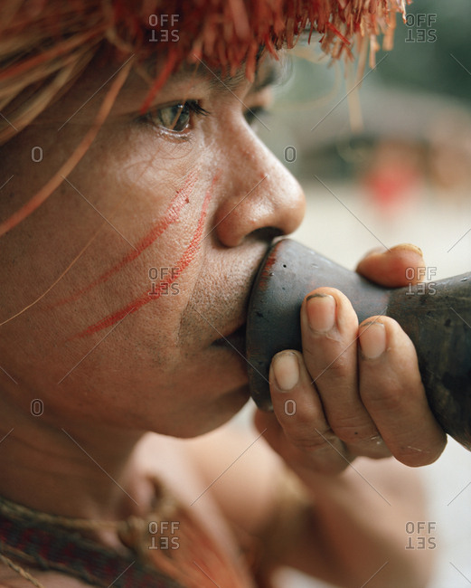 October 5, 2010: PERU, Amazon Rainforest, South America, Latin America, tribal man holding a blowgun. He is part of the Yagua Tribe.