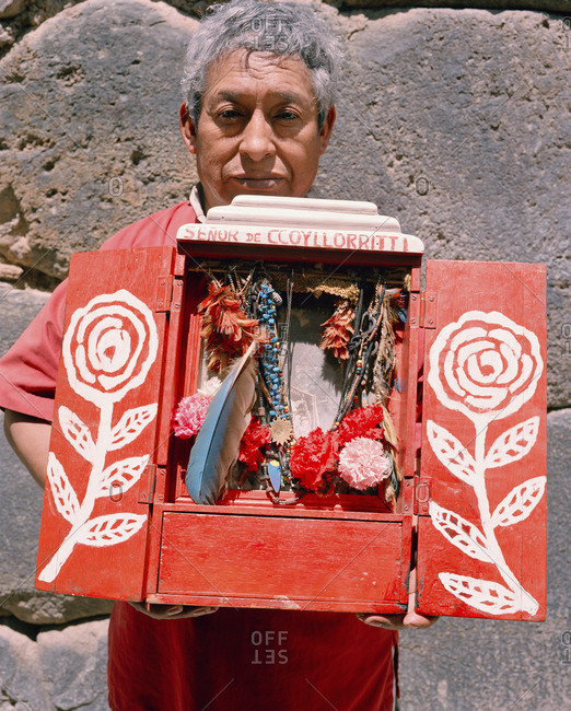 October 5, 2010: PERU, Urubamba, South America, Latin America, mature man holding a sacred object