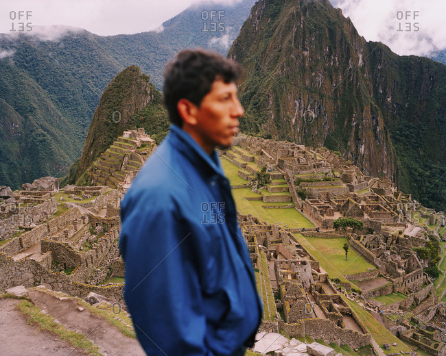 October 5, 2010: PERU, Machu Picchu, South America, Latin America, side view of a man with Machu Picchu in the background.