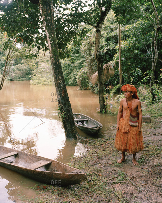 October 5, 2010: PERU, Amazon Rainforest, South America, Latin America, tribal man standing by boat
