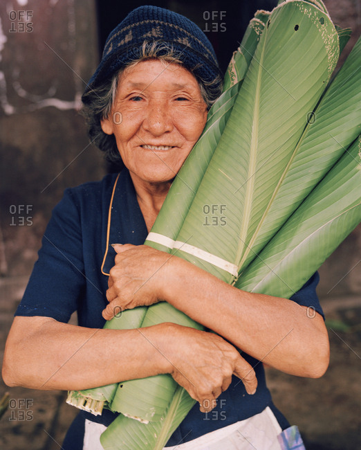 October 5, 2010: PERU, Belen, South America, Latin America, senior woman holding banana leaves that she is selling at the Belen Market.