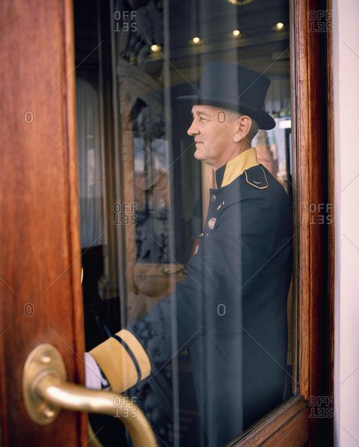 April 13, 2017: RUSSIA, Moscow, Kremlin, door attendant standing by door of the National Hotel