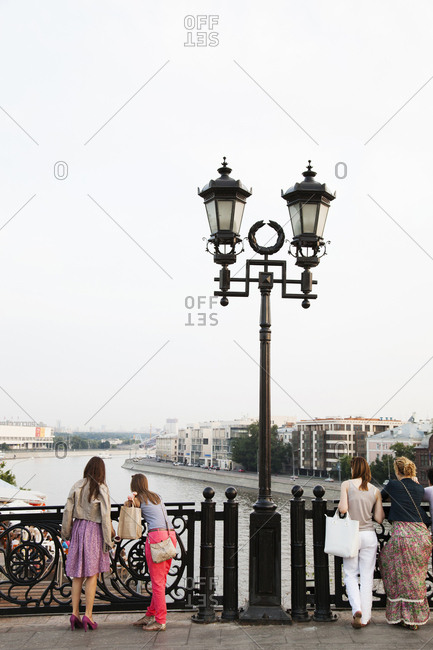July 3, 2011: RUSSIA, Moscow. People sightseeing on the Patriarshy Bridge over the Moscow River.