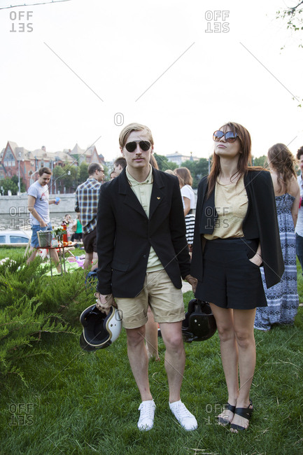 July 3, 2011: RUSSIA, Moscow. Young Muscovites hanging out at a small park at the Strelka Institute by the Moscow River.