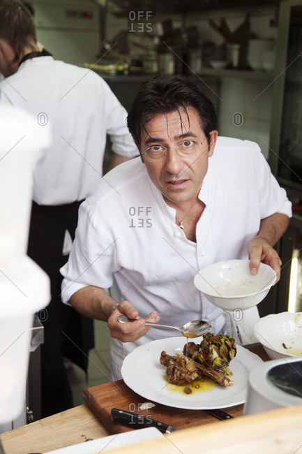 July 5, 2011: RUSSIA, Moscow. Chef Valentino Bontempi finishing a dish at his restaurant, Bontempi.