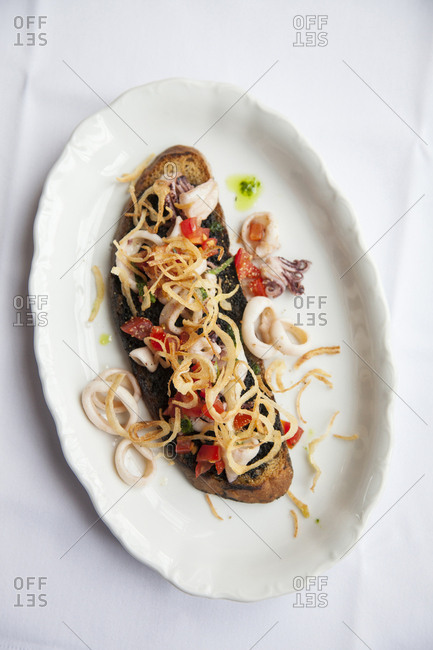 July 5, 2011: RUSSIA, Moscow. A squid dish at Bontempi Restaurant.