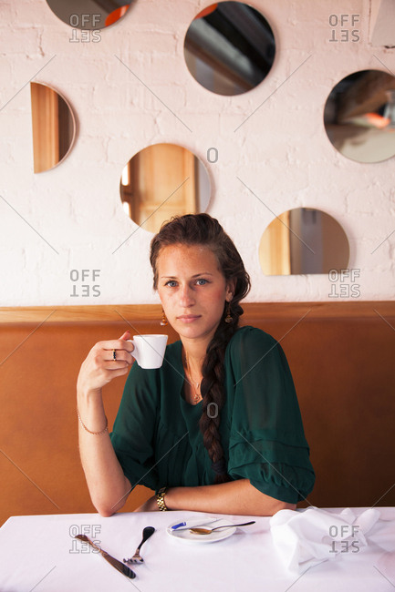 July 5, 2011: RUSSIA, Moscow. Young woman having espresso at Bontempi Restaurant.