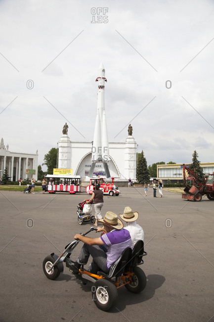 July 6, 2011: RUSSIA, Moscow. Visitors at the space pavilion with a copy of the Vostok Rocket at the All-Russia Exhibition Center.