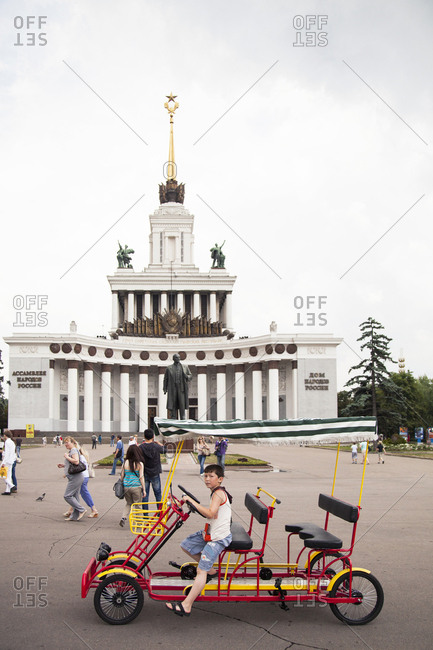 July 6, 2011: RUSSIA, Moscow. Tourists and local visitors in front of the Vladimir Lenin Monument at the All-Russia Exhibition Center.
