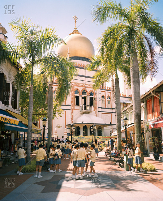 June 21, 2010: SINGAPORE, school children playing in front of Masjid Sultan Singapore Mosque