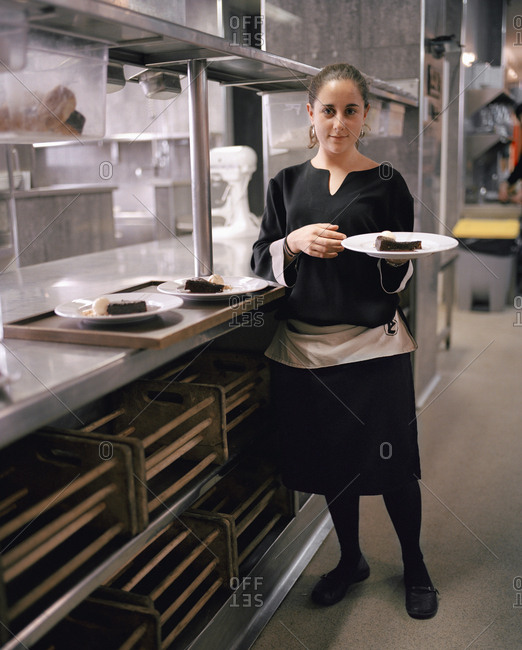 April 13, 2017: SPAIN, El Rioja, young waitress holding plate in the Echaurren kitchen