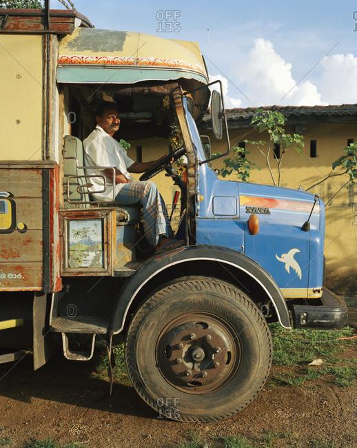 April 13, 2017: SRI LANKA, Asia, portrait of a driver sitting in truck