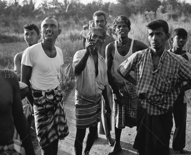 April 13, 2017: SRI LANKA, Asia, group of local villagers looking up (B&W)