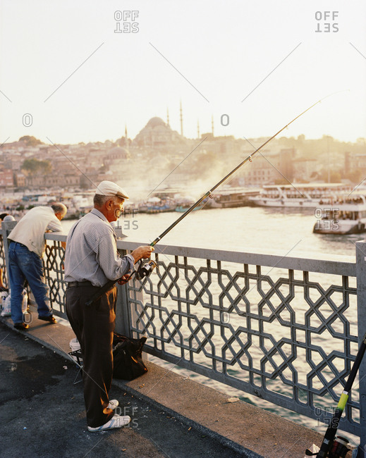 December 20, 2010: TURKEY, Istanbul, senior men fishing at Galata bridge