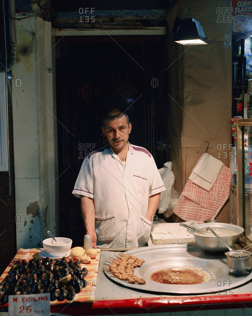 December 20, 2010: TURKEY, Istanbul, portrait of a Mussel vendor at Balik Pazari