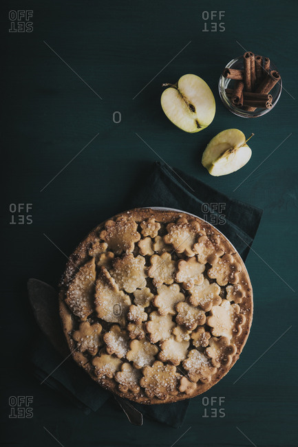 Fancy apple pie with apples and cinnamon overhead shot