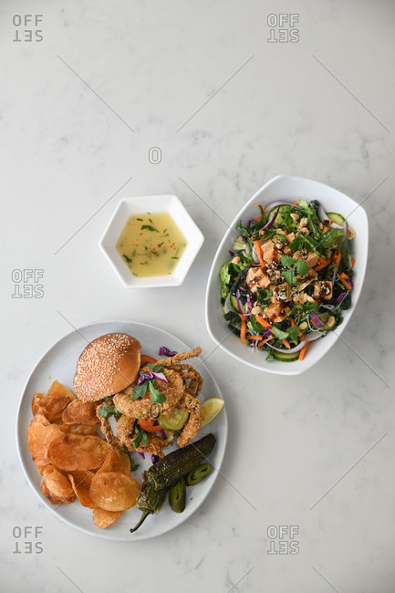 Fried soft-shell crab sandwich served with tofu salad