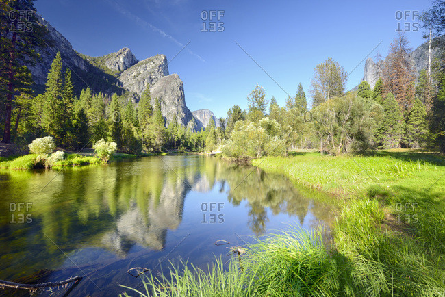 United States, California, Yosemite National Park, Three Brothers peaks reflected in Merced river.