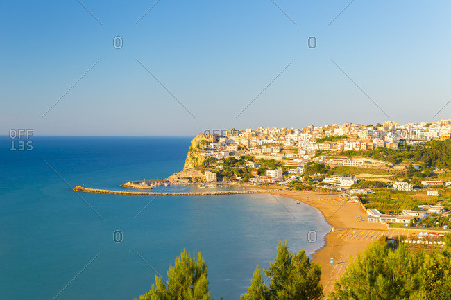 Italy, Apulia, Foggia district, Gargano, Peschici, Mediterranean sea, Adriatic sea, Adriatic Coast, Gargano National Park, The village of Peschici perched on a cliff overlooking the sea at sunset