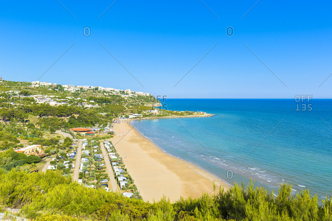 Italy, Apulia, Foggia district, Gargano, Peschici, Mediterranean sea, Adriatic sea, Adriatic Coast, Gargano National Park, Bay of San Nicola a beach near Peschici, along the Gargano coast.