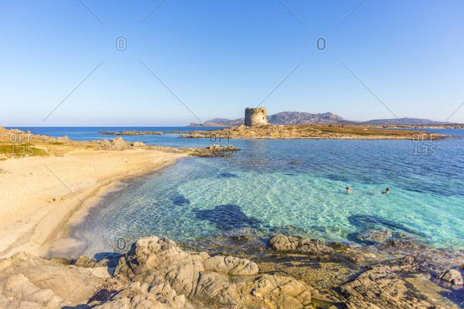 Italy, Sardinia, Sassari district, Stintino, La Pelosa beach, Mediterranean sea, La Pelosa beach and the tower, Asinara Island in the background