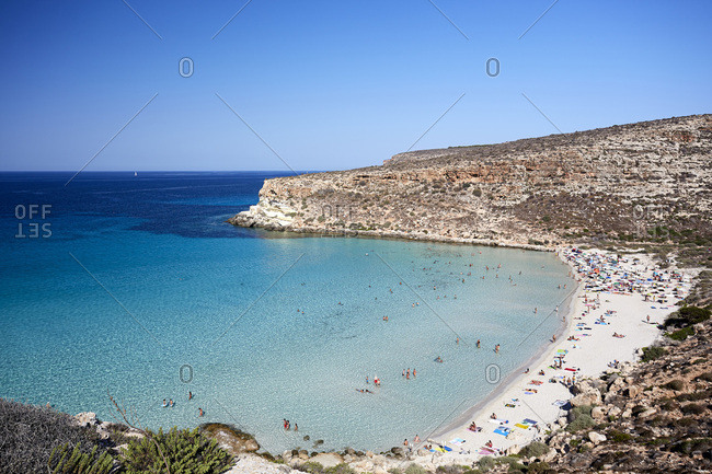 Italy, Sicily, Agrigento district, Pelagie islands, Lampedusa, Mediterranean sea, Spiaggia dei Conigli beach, spotted in summertime where tourist can enjoy its turquoise and crystal clear water. This site is part of Lampedusa natural reserve and is also known for turtles to leave their eggs