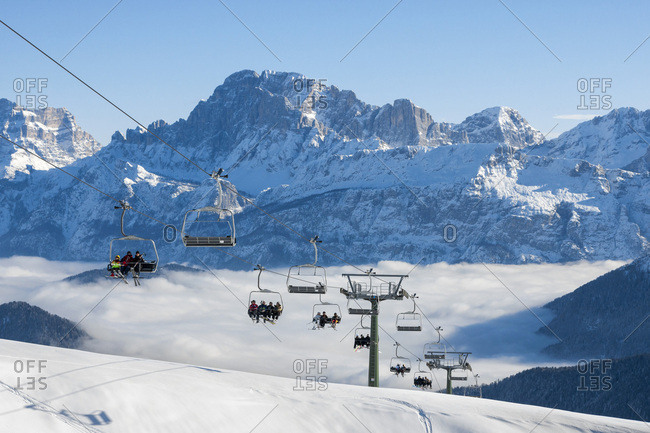 January 17, 2010: Italy, Veneto, Belluno district, Alto Agordino, Falcade, Alps, Dolomites, Falcade chair lift with Monte Civetta in the background