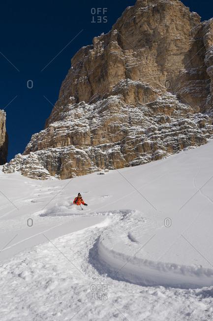December 29, 2017: Italy, Trentino-Alto Adige, Trento district, Val di Fassa, Passo Pordoi, Alps, Dolomites, Skiing the Forcella Pordoi in perfect powder snow, Sella Group, Dolomites