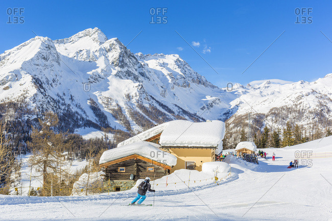 January 23, 2018: Italy, Aosta Valley, Aosta district, Valle d'Ayas, Champoluc, Alps, Monterosa Ski, Monterosa ski resort, a skiers / snowboarders on ski slopes at alpe Ciarcerio in Frachey