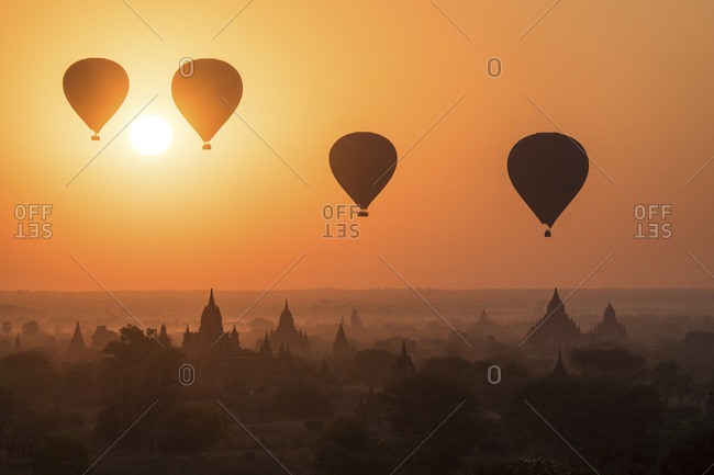 Myanmar, Mandalay, Bagan, Bagan Valley, hot air balloons rising over Bagan Temples at sunrise