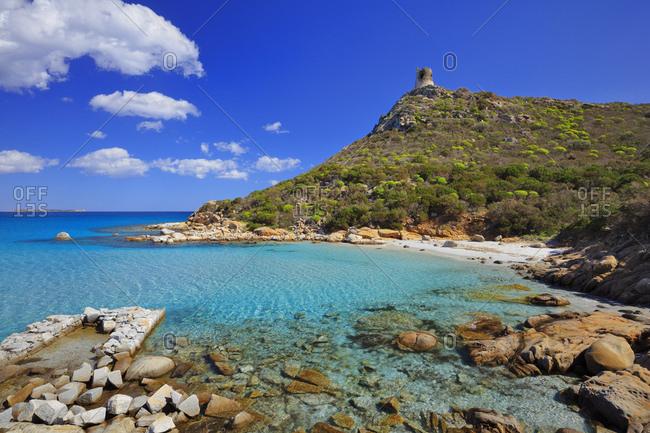 Italy, Sardinia, Cagliari district, Villasimius, Porto Giunco, Mediterranean sea, Porto Giunco beach and Genovese viewing tower