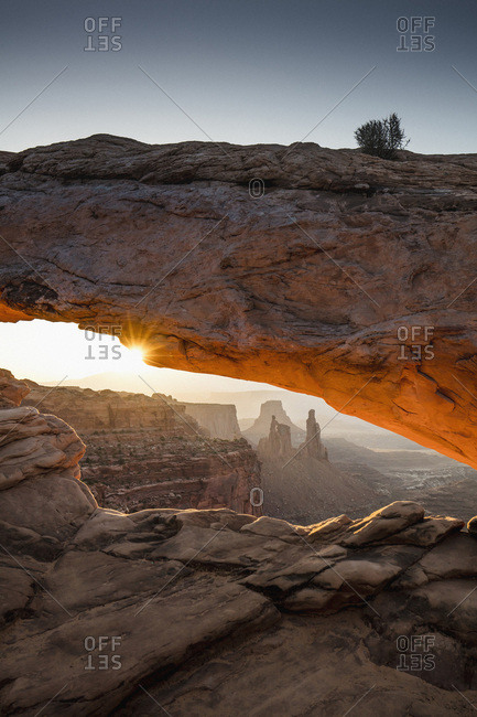United States, Utah, Canyonlands National Park, The iconic view of Mesa arch with Canyonlands National Park (island in the Sky) in the background at sunrise