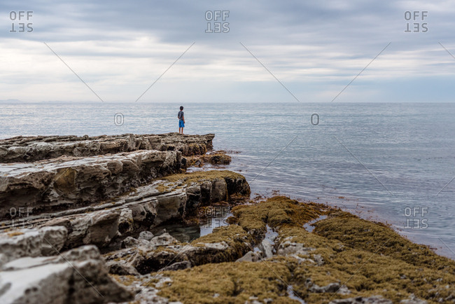 Young man standing at the edge off a jetty
