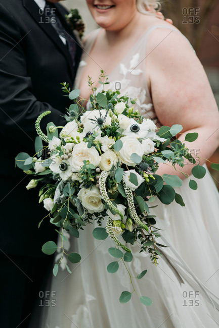 Smiling bride with unique bouquet