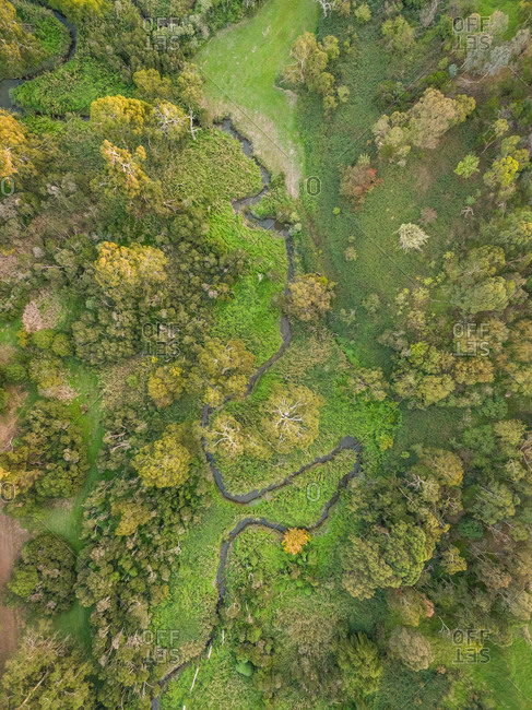 Aerial view of small stream crossing vegetation in zigzag path, Australia.