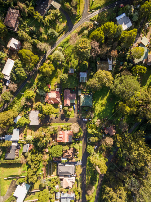 Aerial view of countryside neighborhood surrounded by trees, Australia.