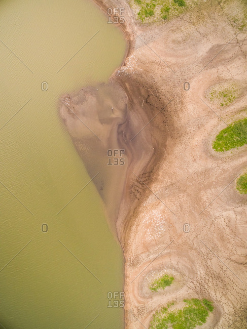 Aerial view of abstract sandy shore near lake, Netherlands.