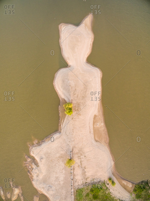 Aerial view of abstract sandy island near lake, Netherlands.