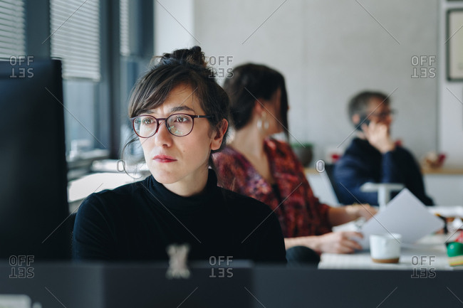 Portrait of  confident businesswoman working on computer in creative office