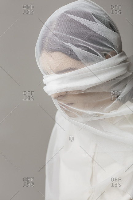 Blindfold woman- wrapped in a veil