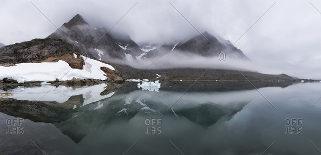 Greenland- Sermersooq- Kulusuk- Schweizerland Alps- mountains reflecting in water
