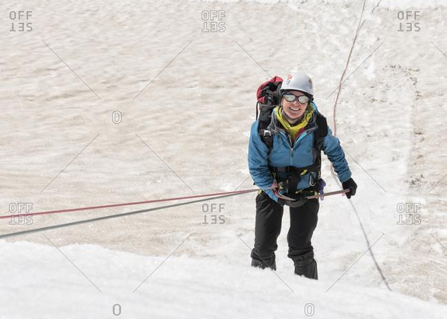 Greenland- Sermersooq- Kulusuk- Schweizerland Alps- portrait of smiling mountaineer in snow