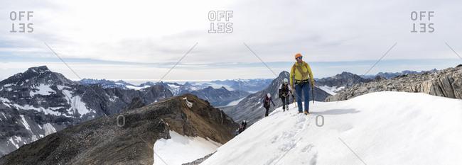 Greenland- Sermersooq- Kulusuk- Schweizerland Alps- group of people walking in snowy mountainscape